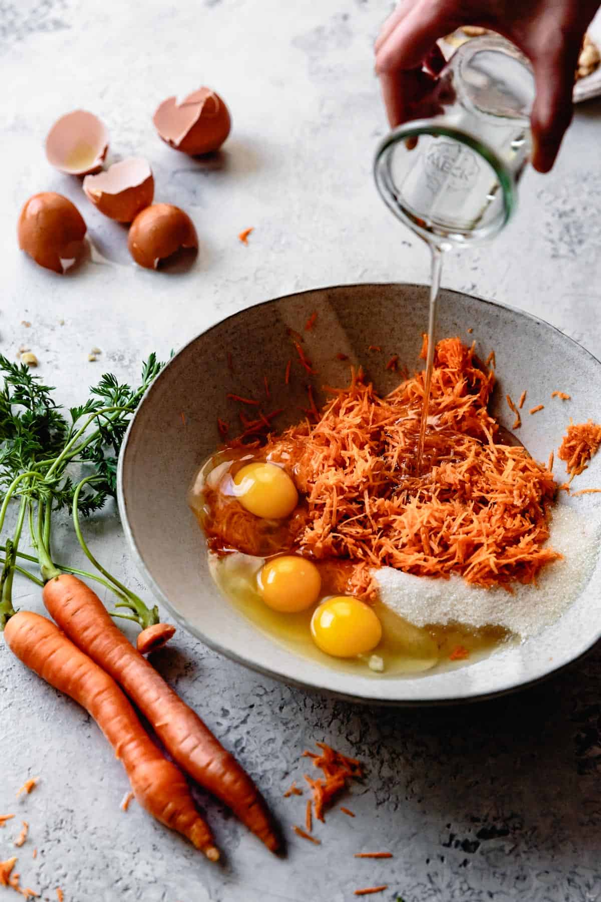 eggs and shredded carrots in bowl