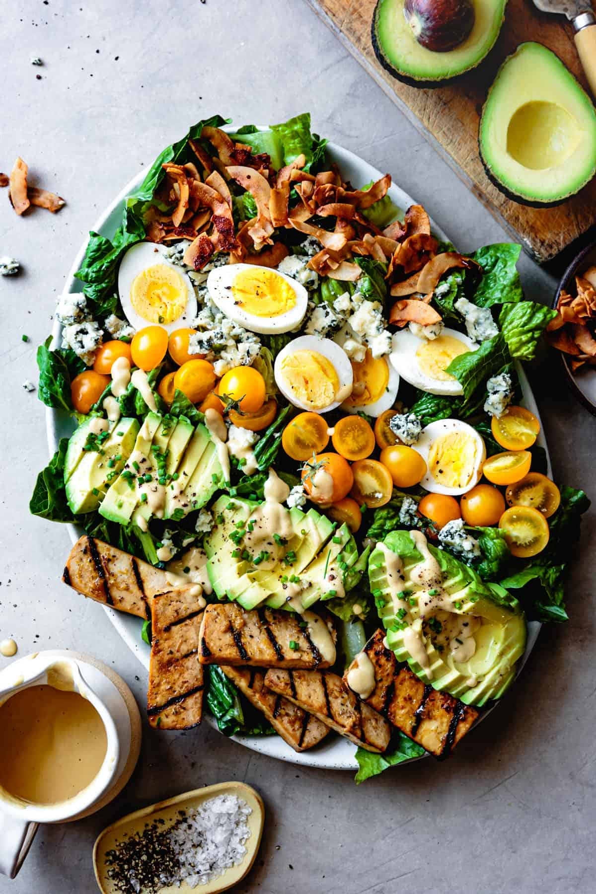 Vegetarian Cobb Salad with Grilled Tofu & Coconut Bacon on table