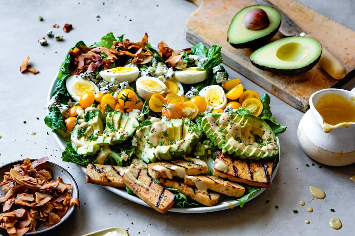 Vegetarian Cobb Salad with Grilled Tofu & Coconut Bacon on big plate