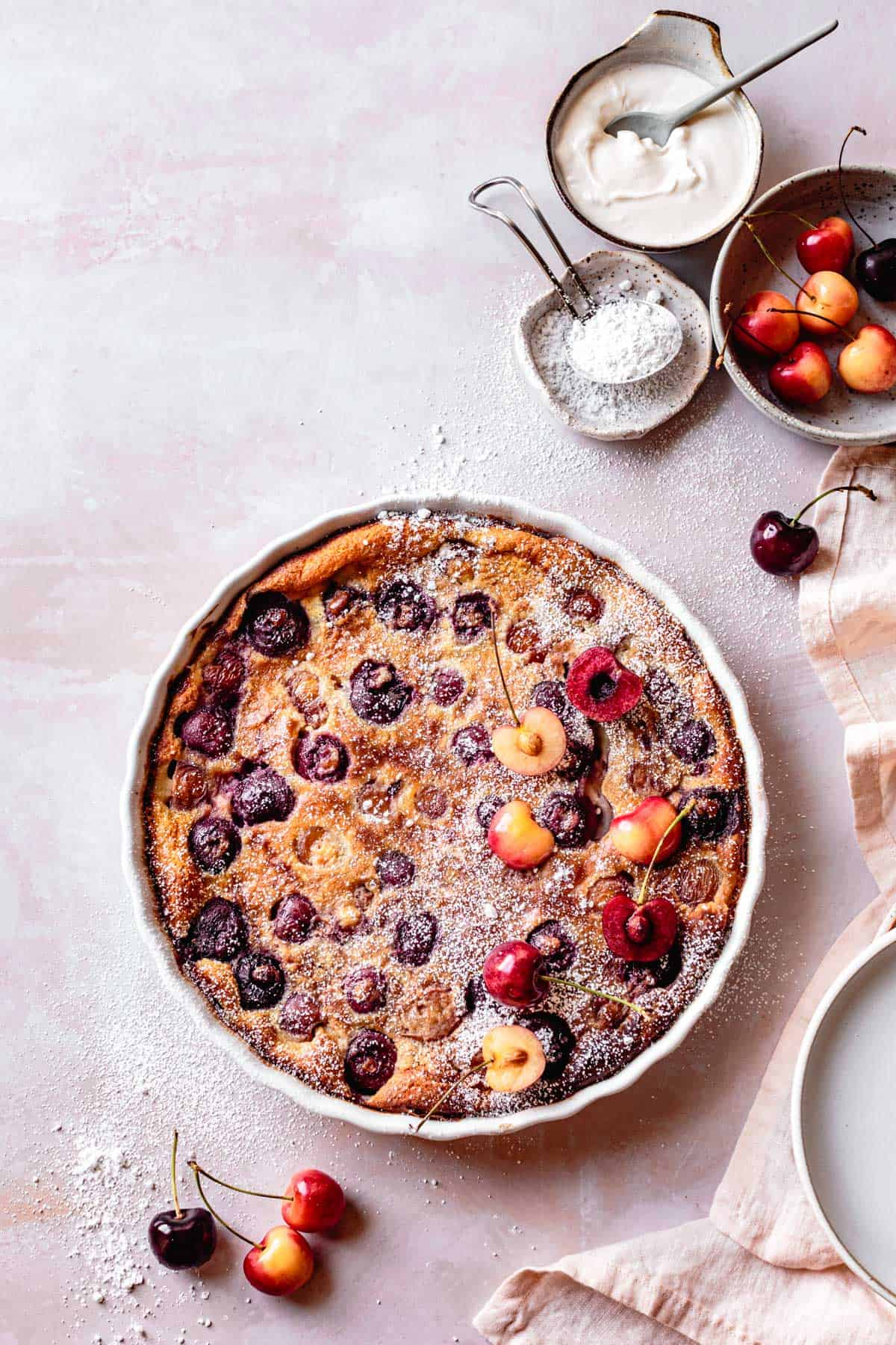 Gluten-Free Cherry Clafoutis recipe, after baking, sprinkled with powdered sugar