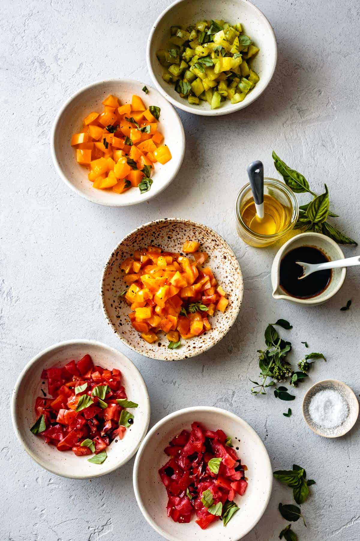 Rainbow bruschetta tomatoes in bowls