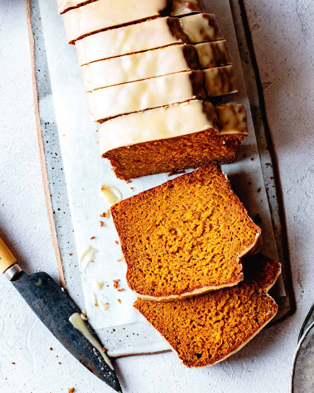 sliced gluten-free pumpkin bread on a ceramic board