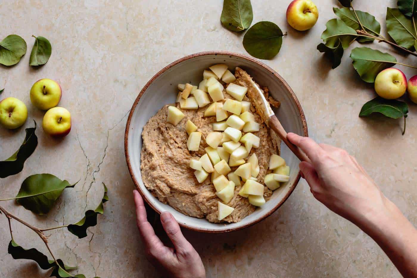 Adding apples to batter for gluten-free apple cake recipe