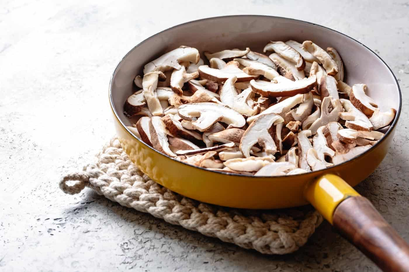 Sliced mushrooms in a pan for making vegetarian mushroom gravy (gluten-free, vegan option)