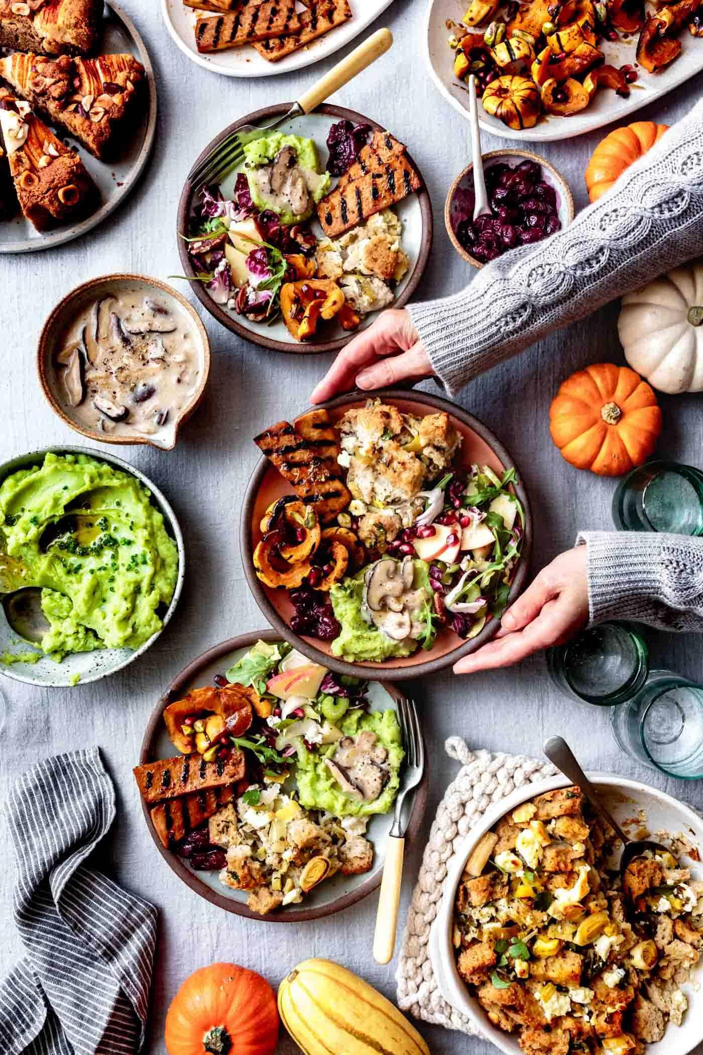Plates of vegetarian gluten-free Thanksgiving dinner