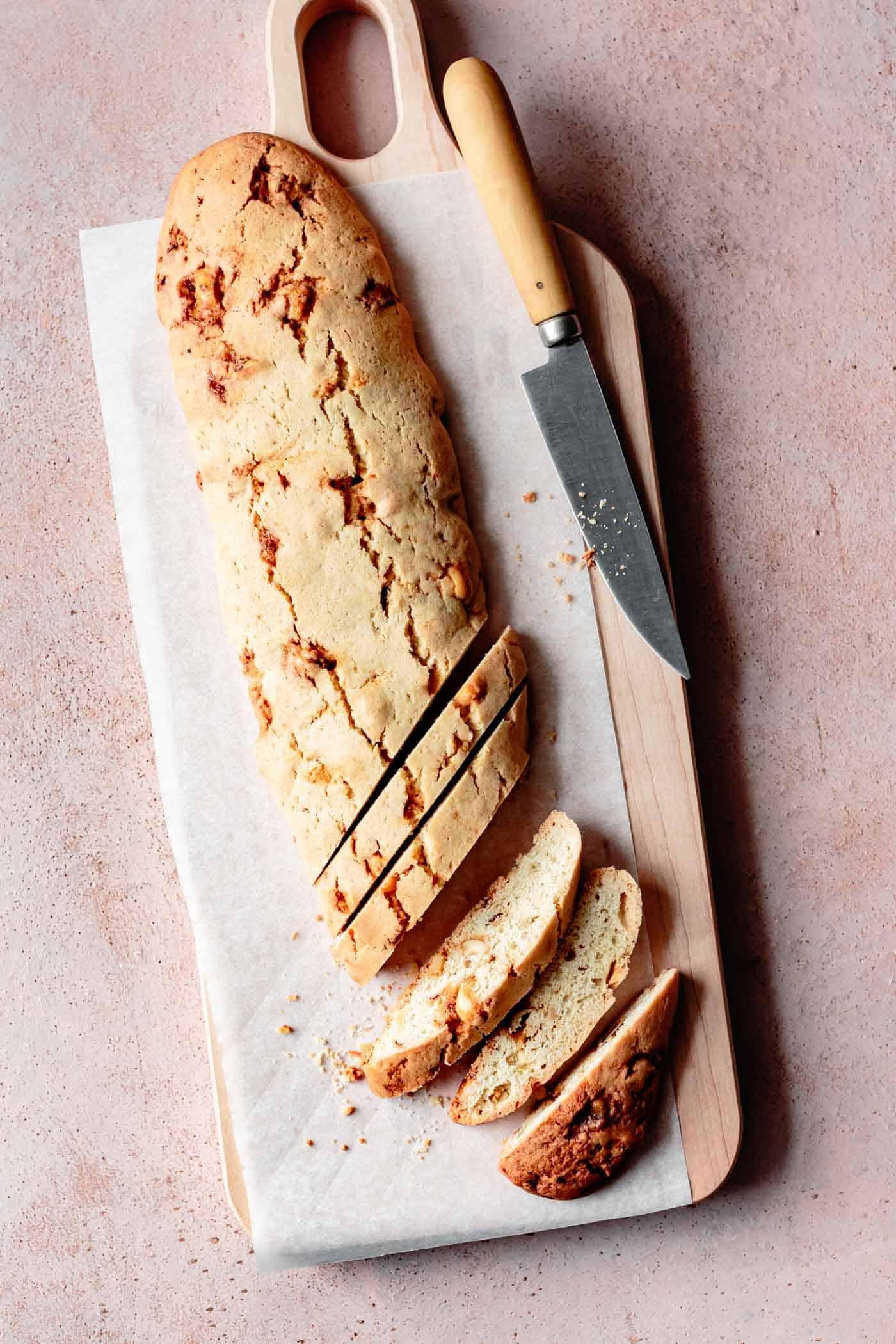 Gluten-free biscotti log being cut into slices