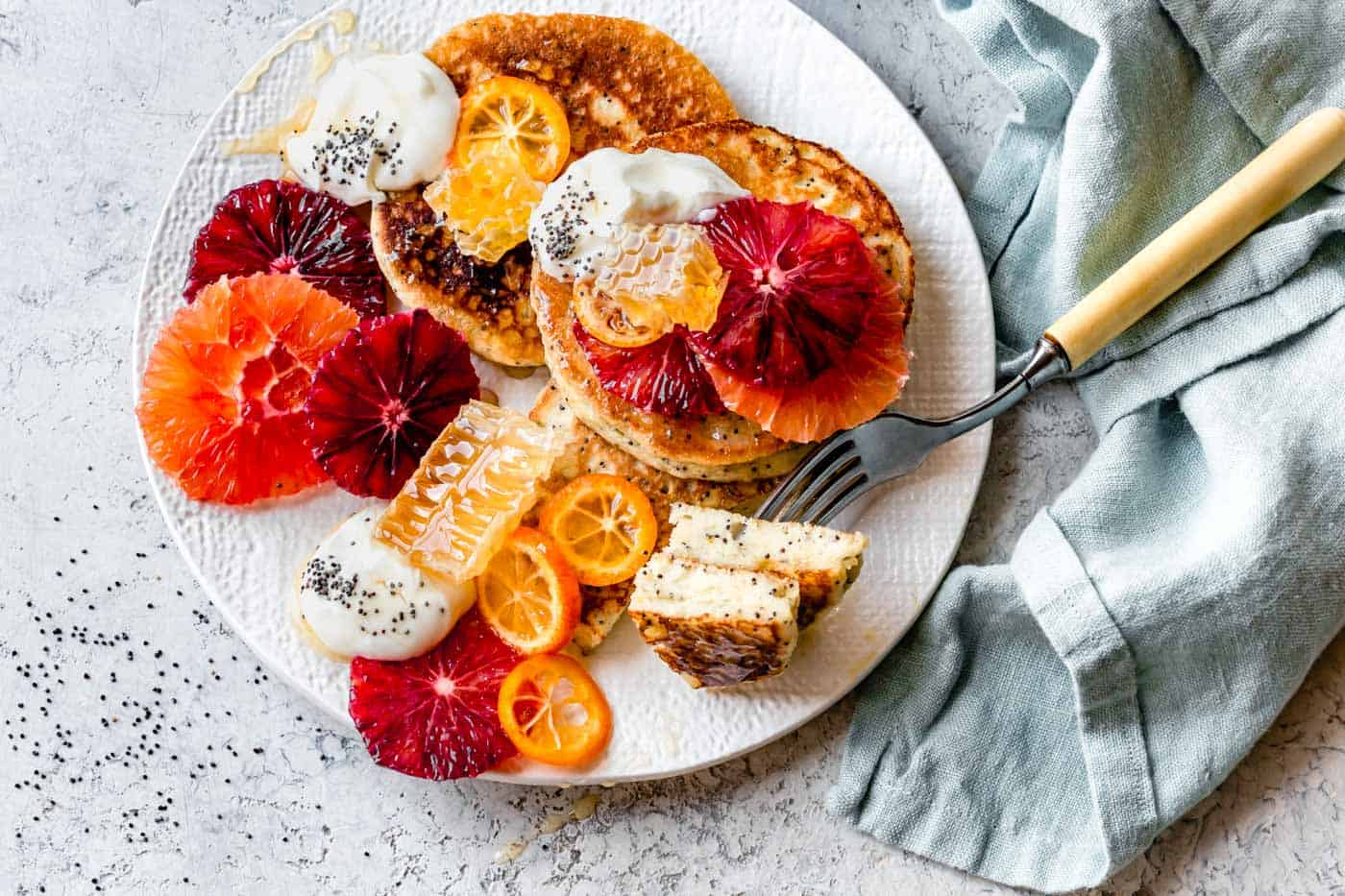 A plate of my best almond flour pancakes with citrus, yogurt, and honey