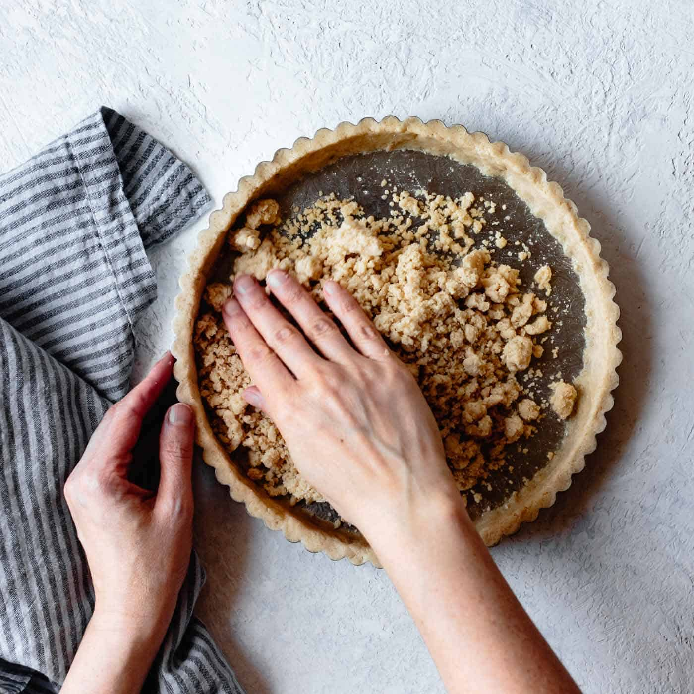pressing crumbs into gluten-free tart shells