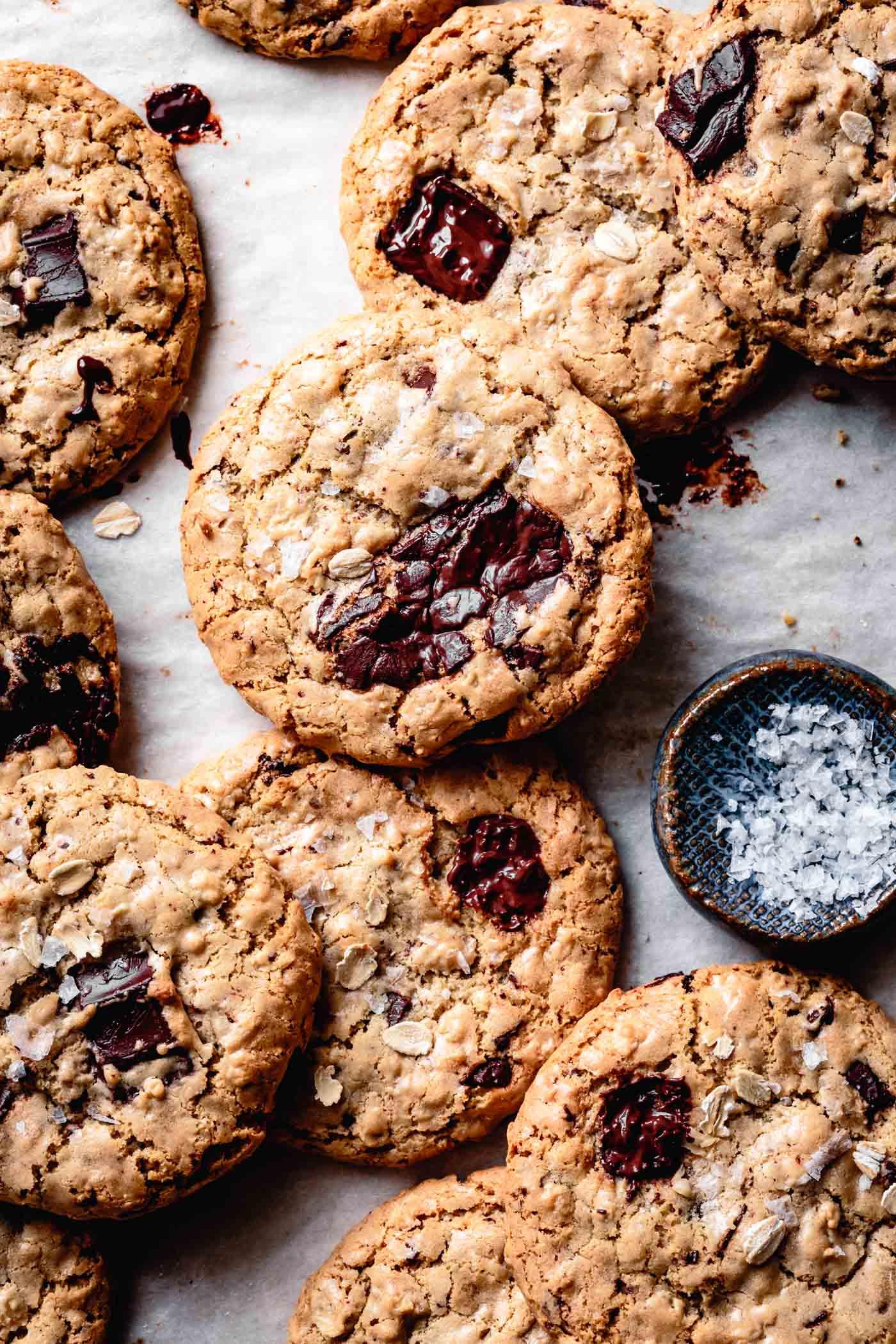Freshly baked vegan gluten-free tahini chocolate chip cookies with flaky salt