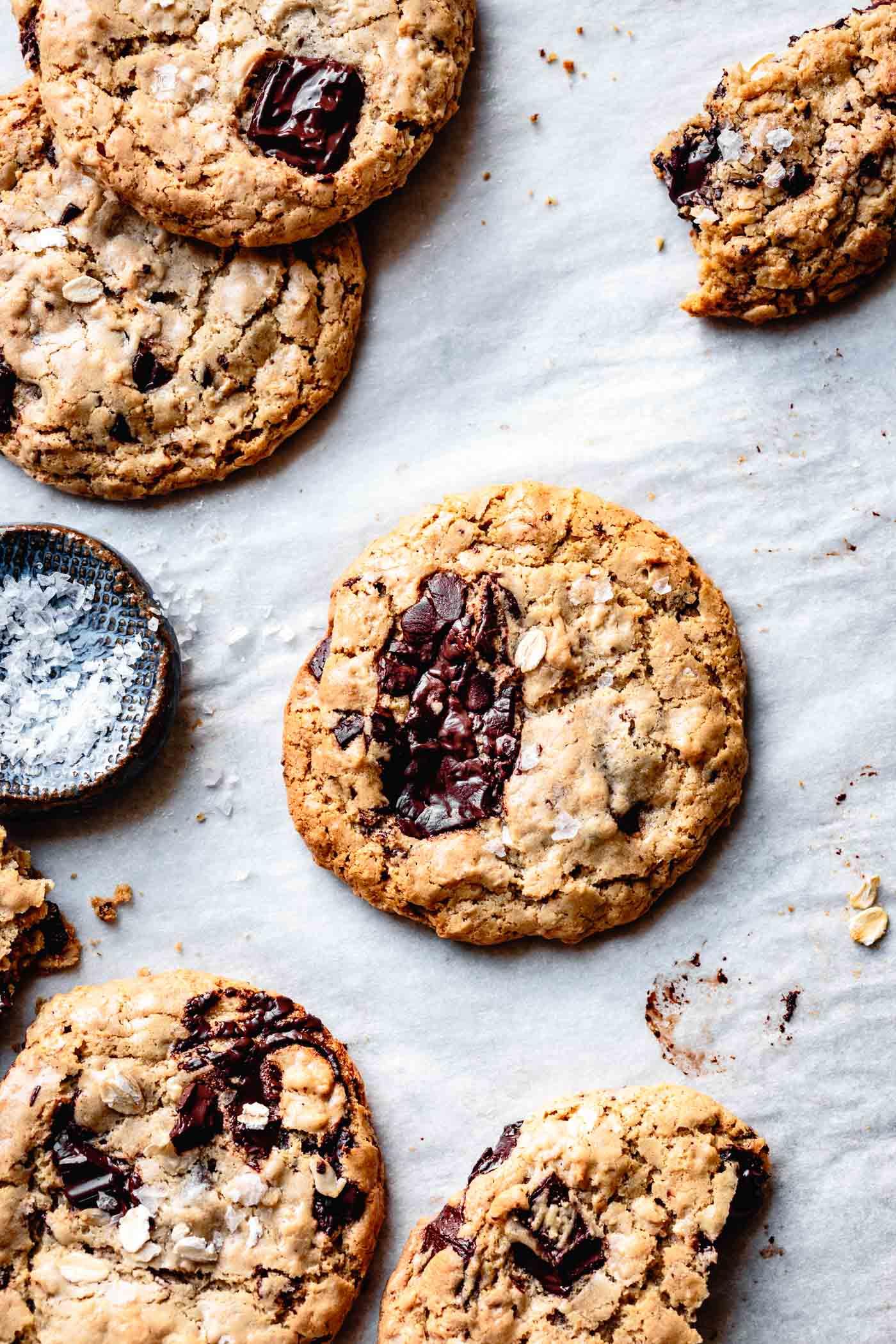 Gooey salted tahini chocolate chip cookies on a baking sheet