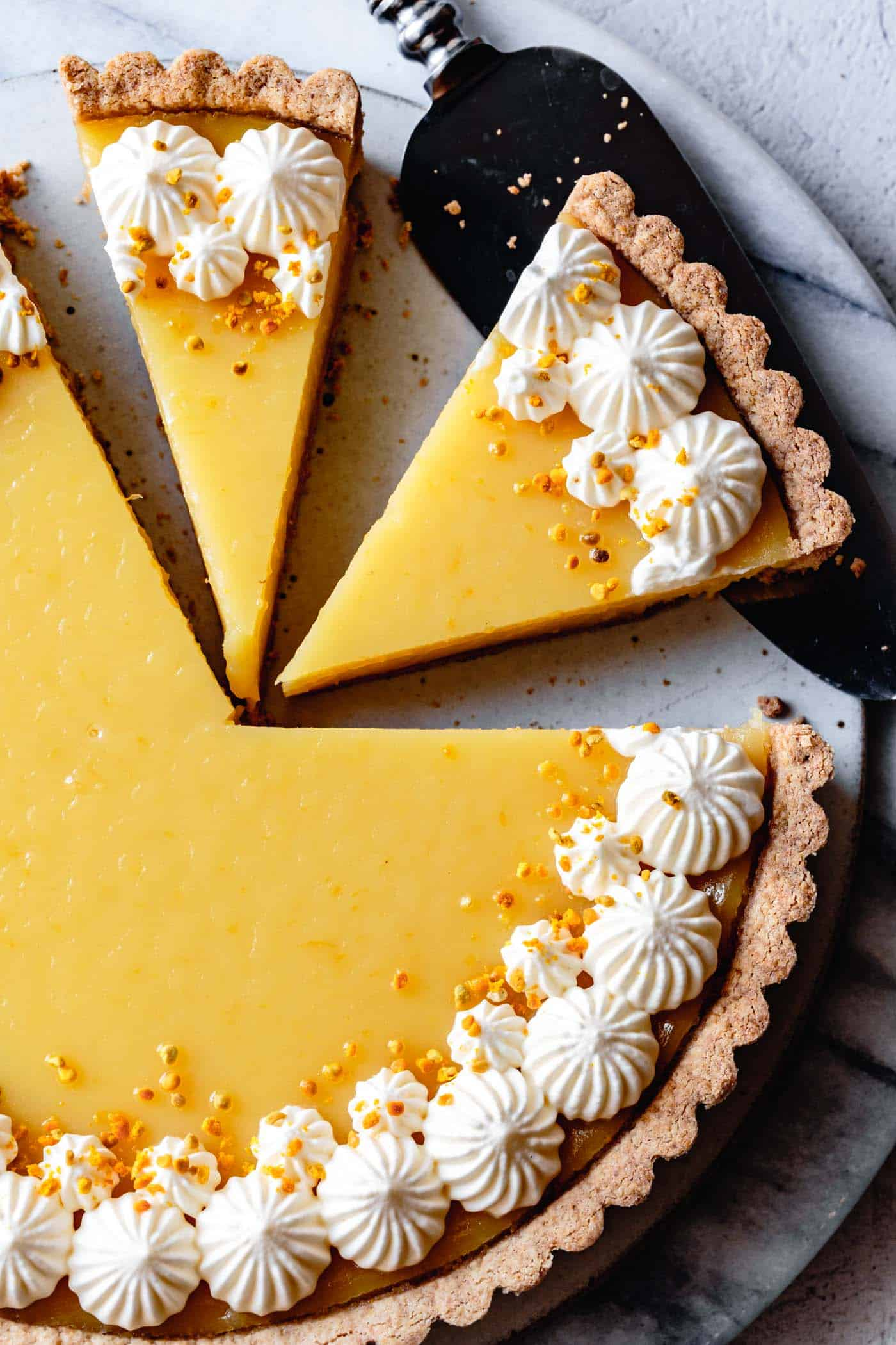 close-up on sliced easy gluten-free lemon curd tart