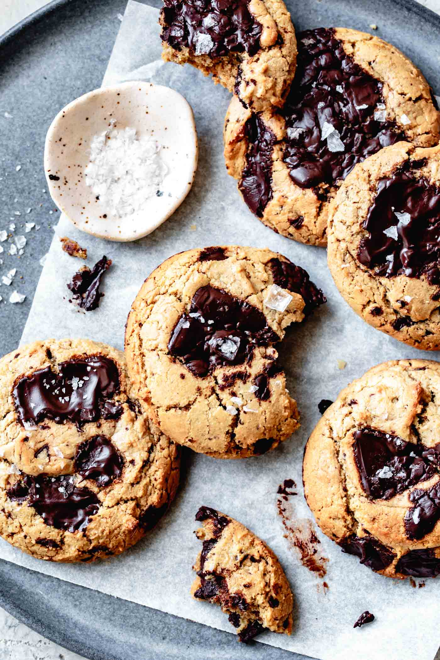 a plate full of glossy paleo vegan chocolate chip cookies