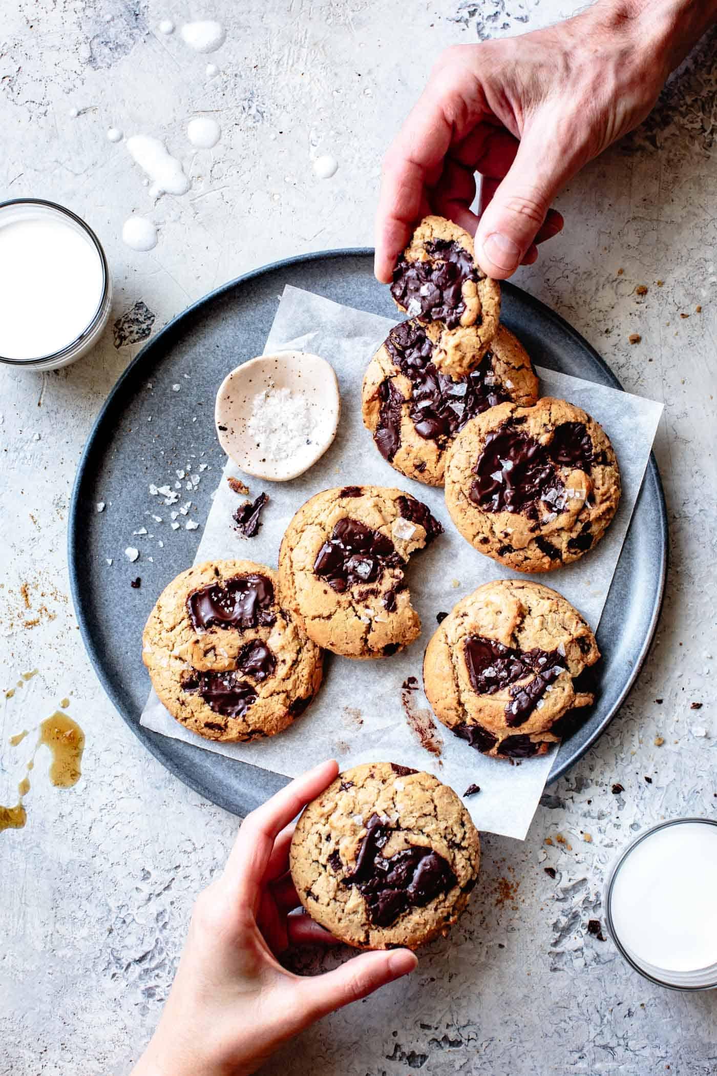 two people eating vegan paleo chocolate chip cookies