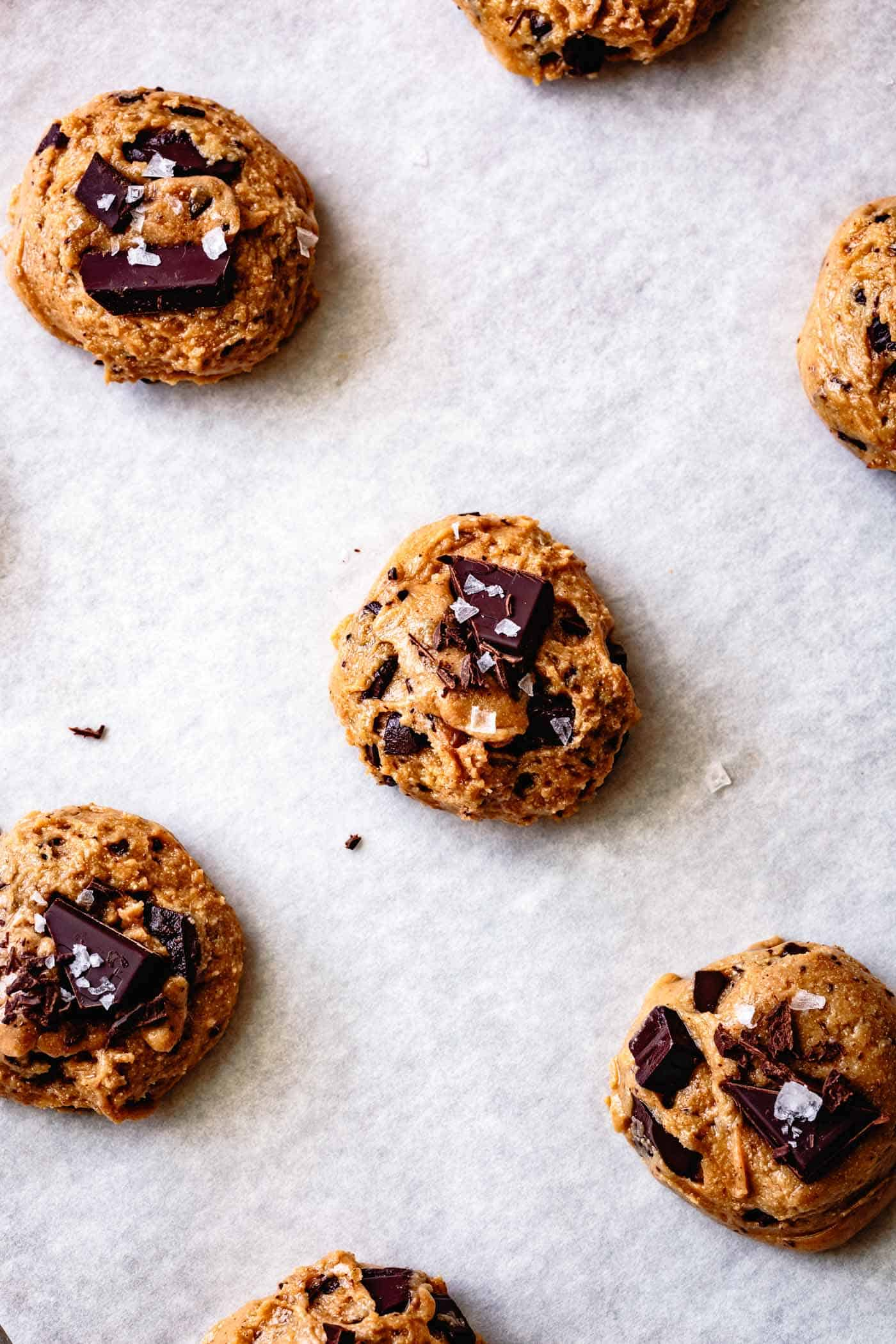 vegan paleo chocolate chip cookies ready to bake on a cookie sheet