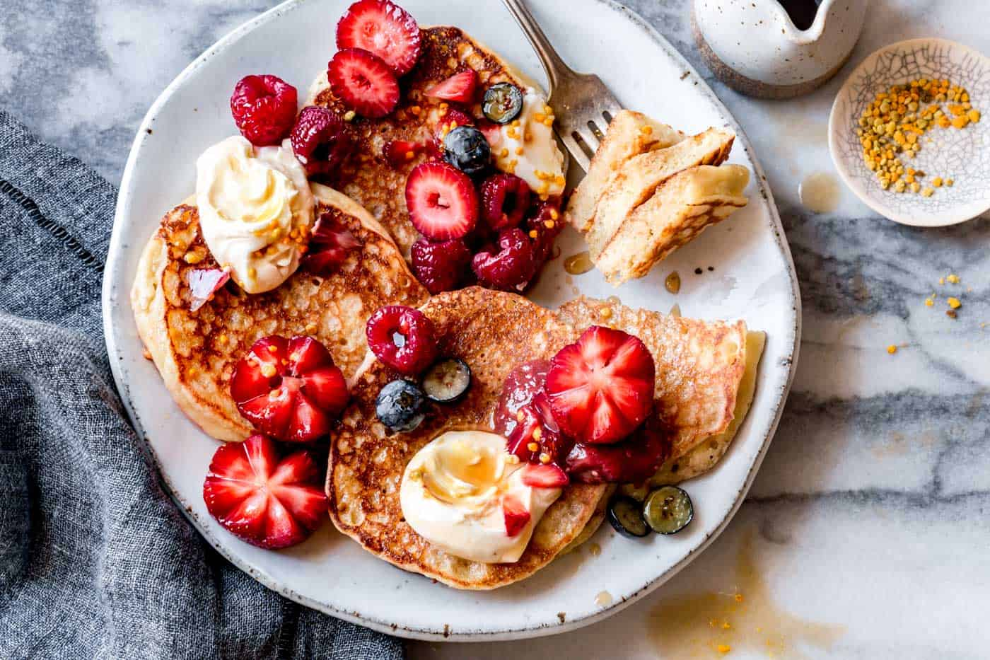 gluten-free lemon ricotta pancakes on a plate, horizontal