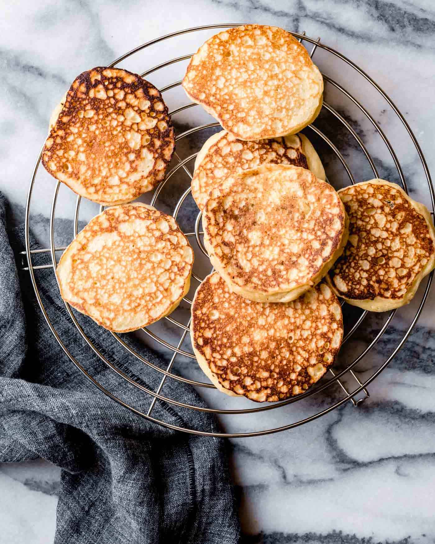 fluffy gluten-free lemon ricotta pancakes recipe on a cooling rack