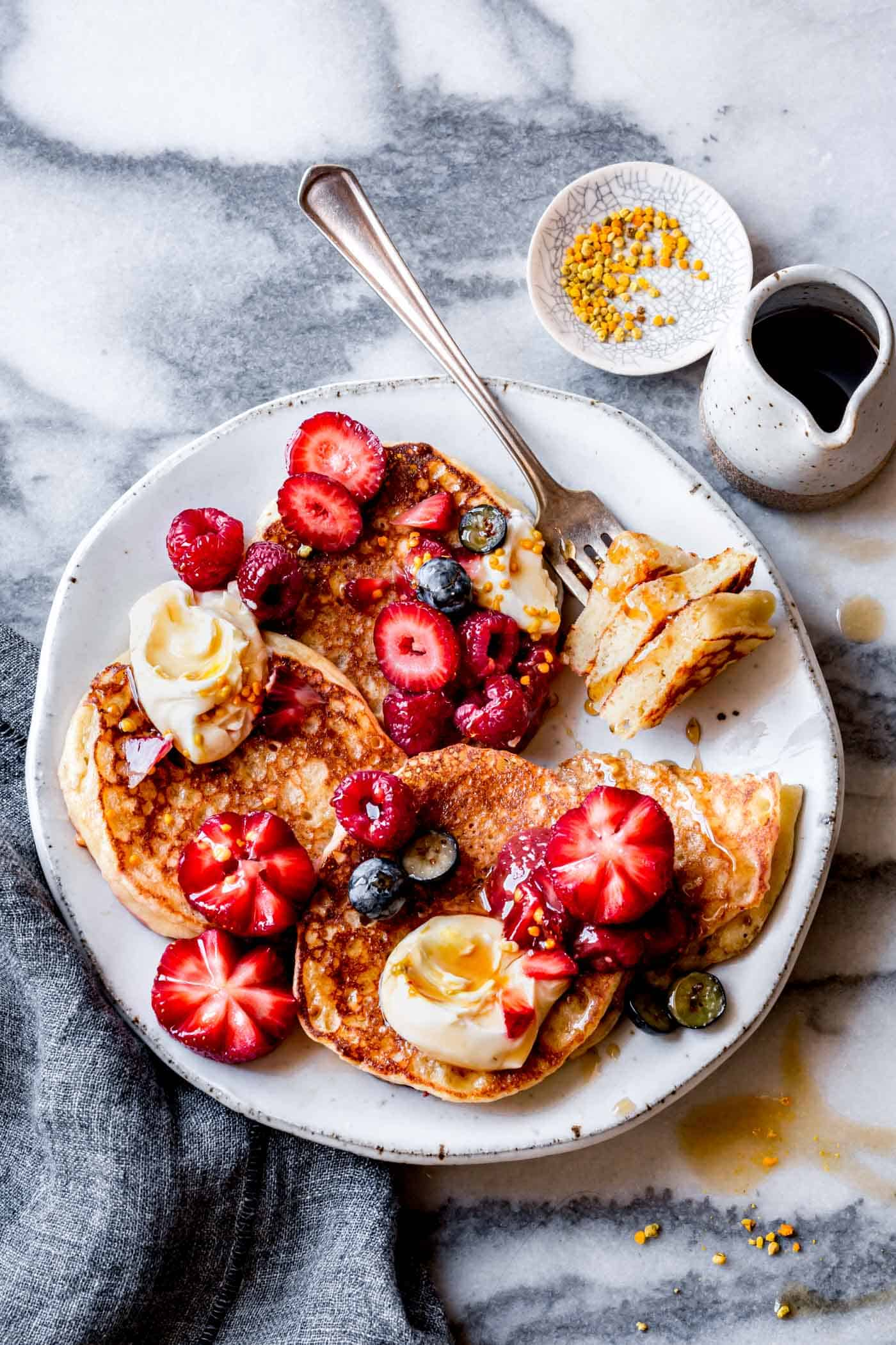 gluten-free lemon ricotta pancakes with fresh berries and yogurt