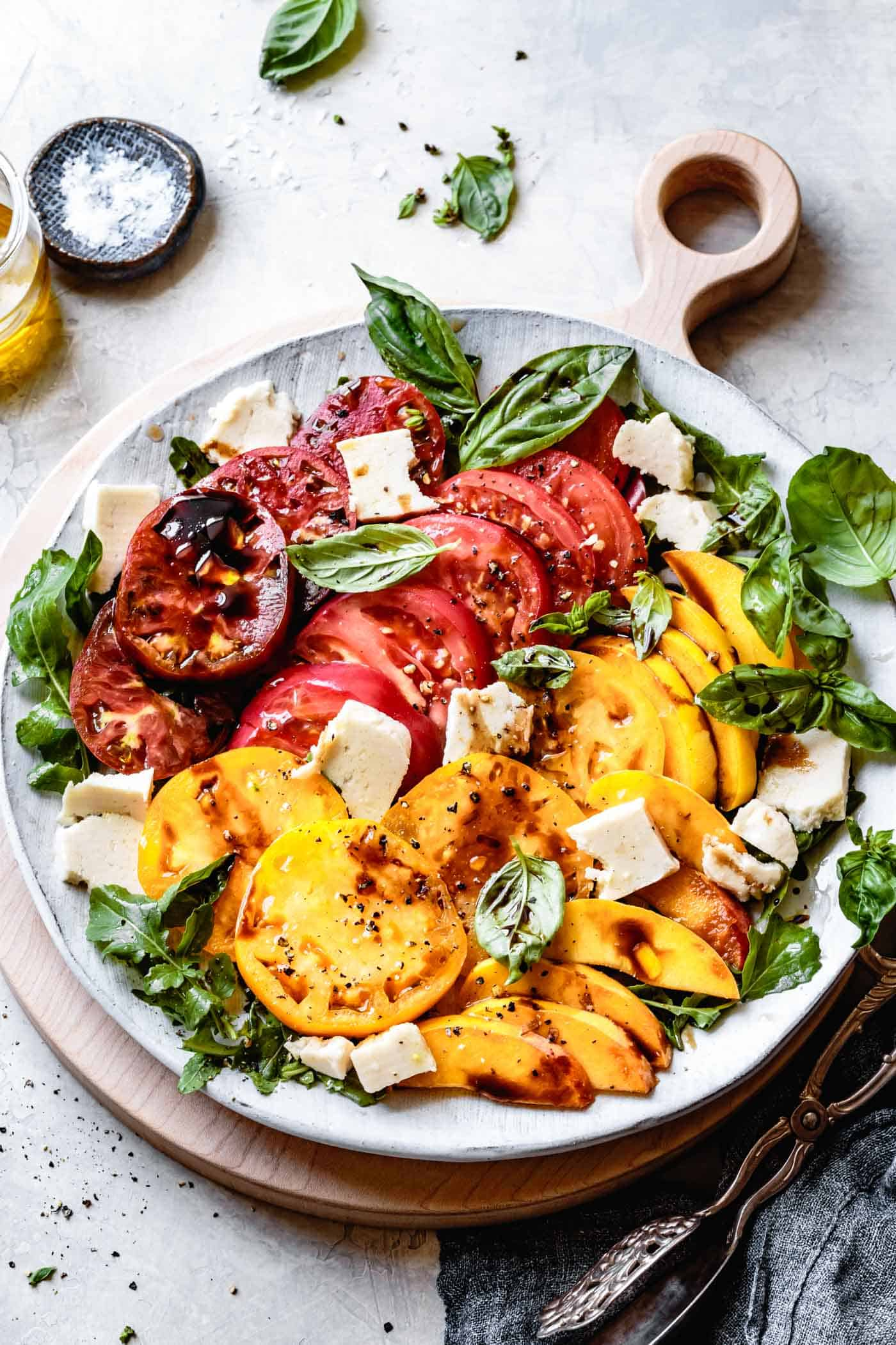 Vegan arugula peach caprese salad recipe on a platter