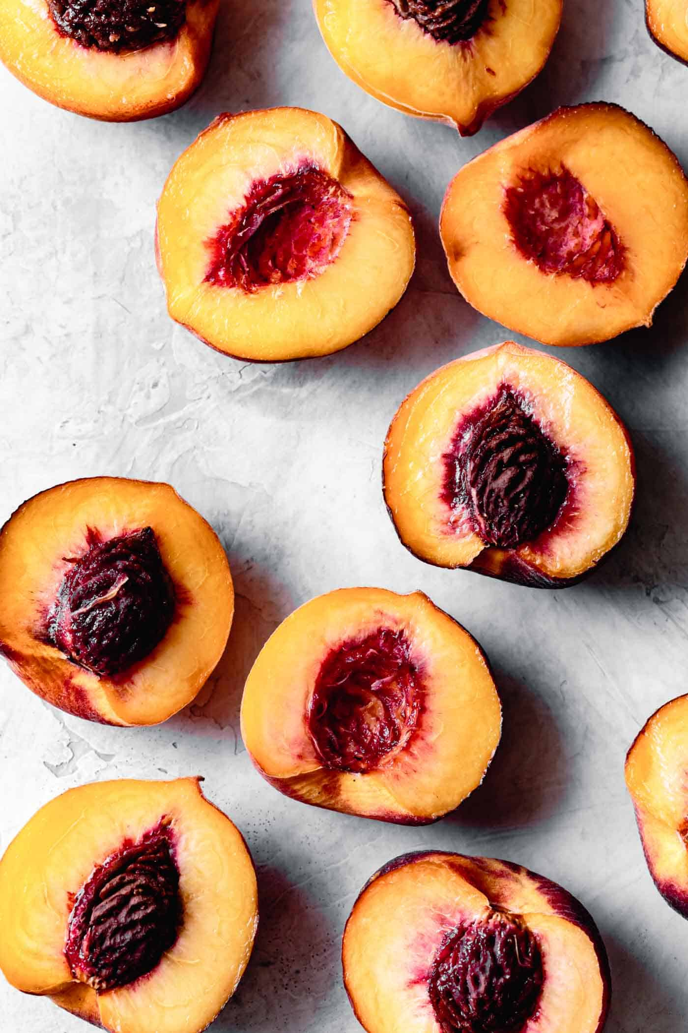halved peaches on a work surface