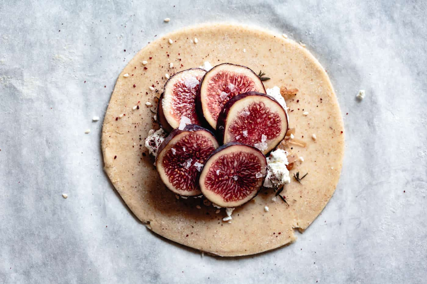 fanning figs over goat cheese for galette recipe