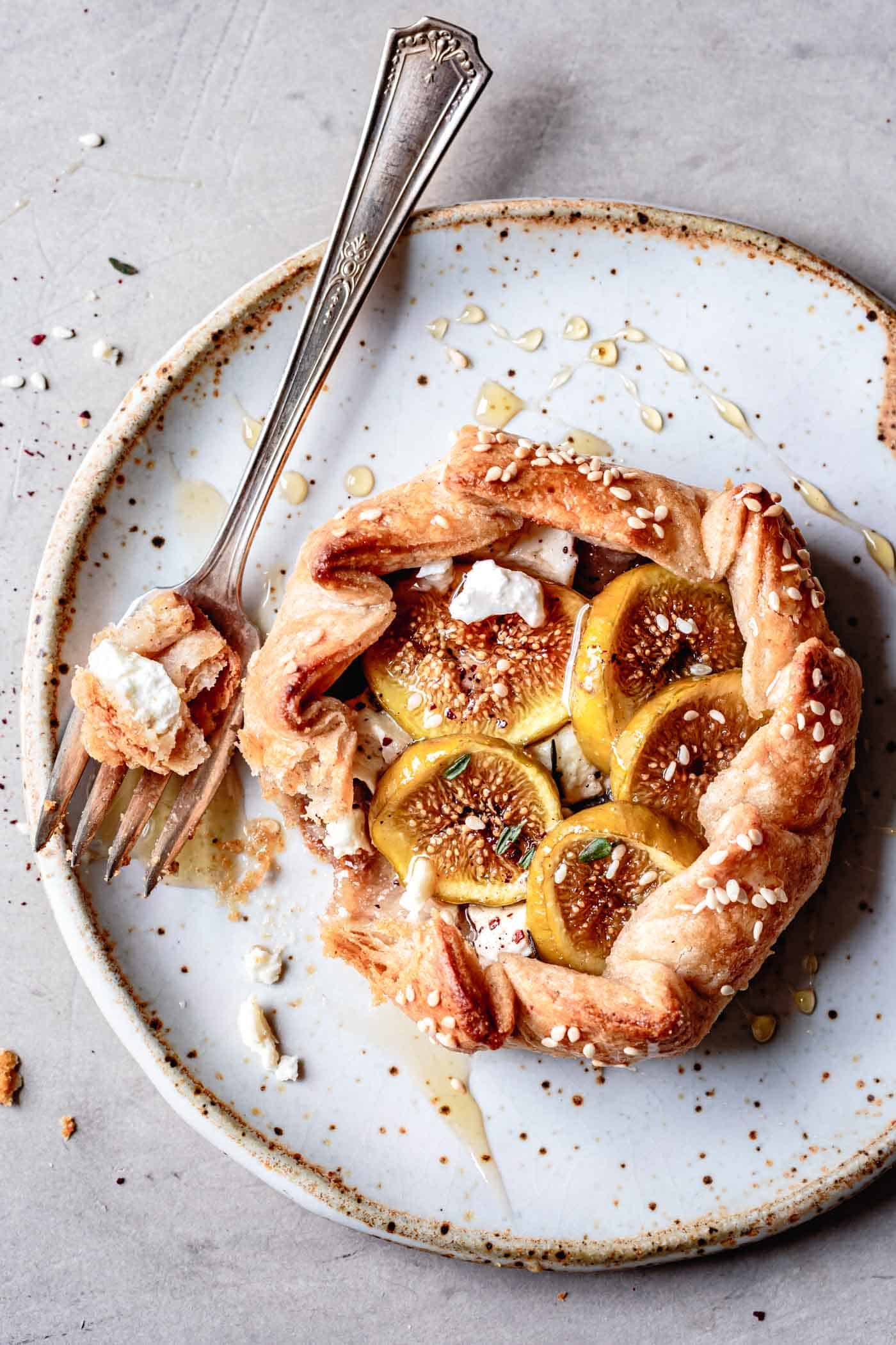 fig galette on a plate, drizzled with honey
