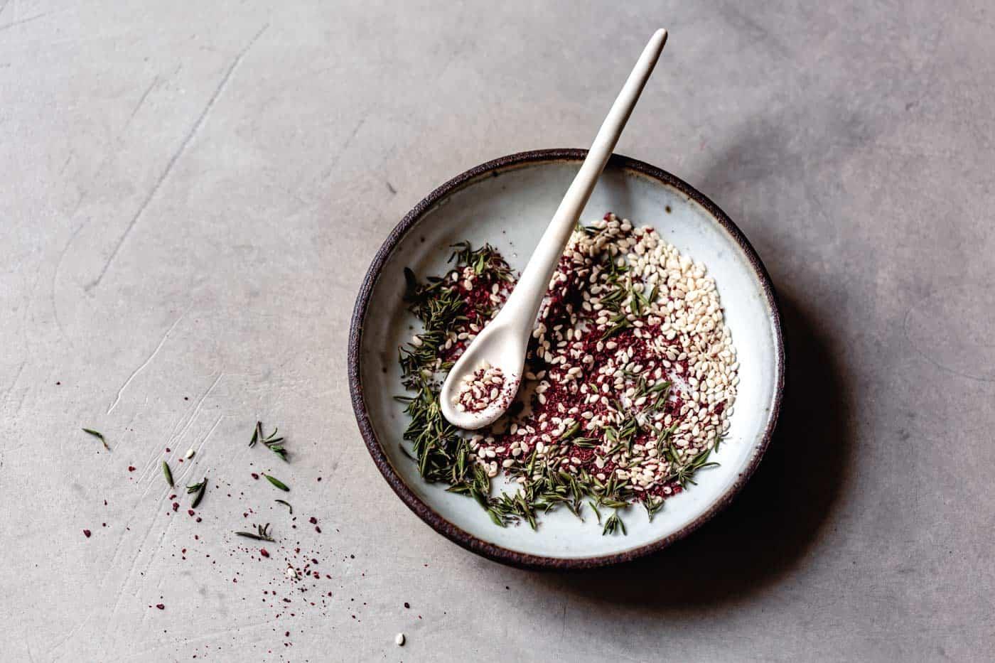 Stirring za'atar in a bowl