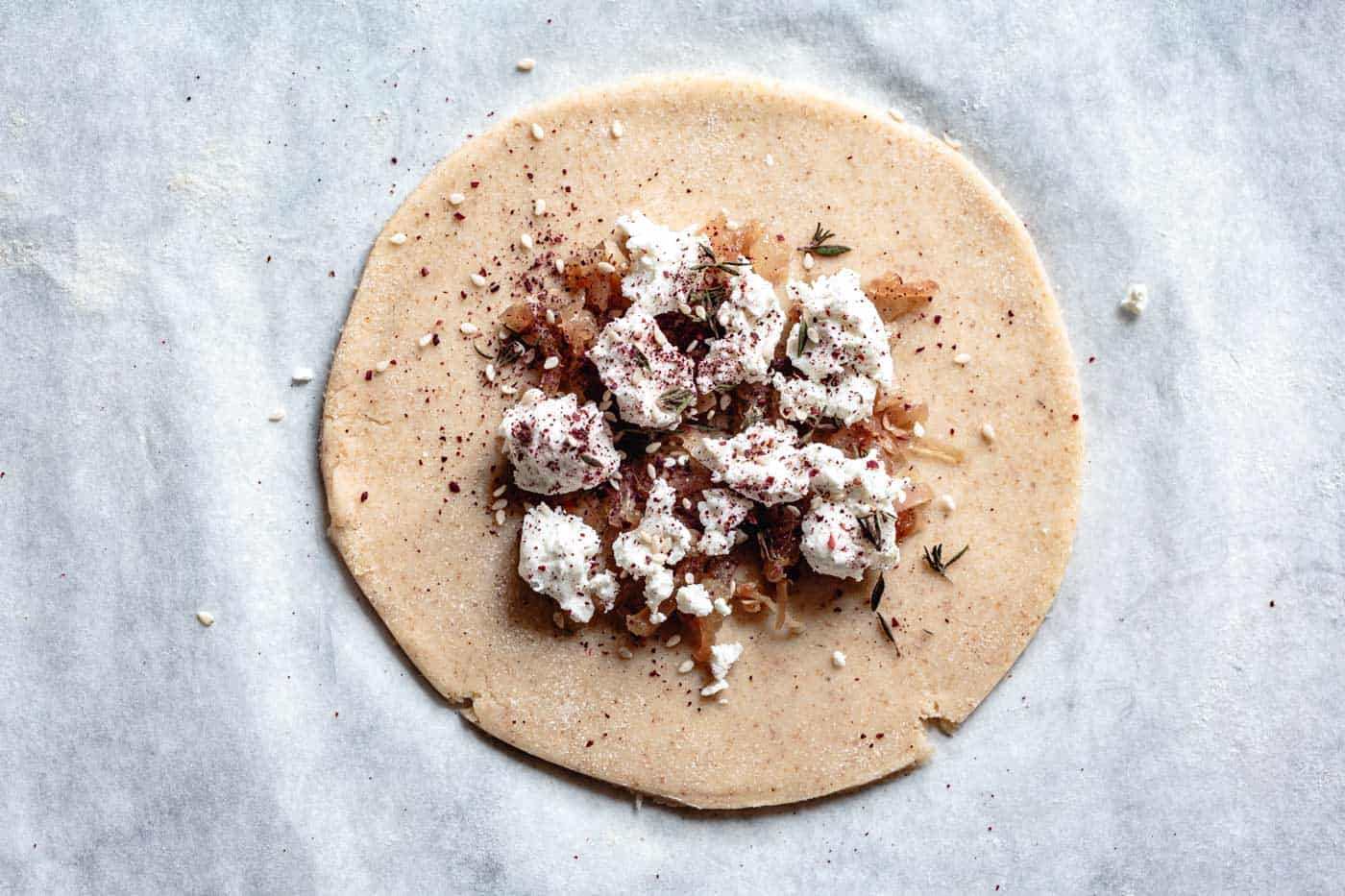sprinkling za'atar over goat cheese