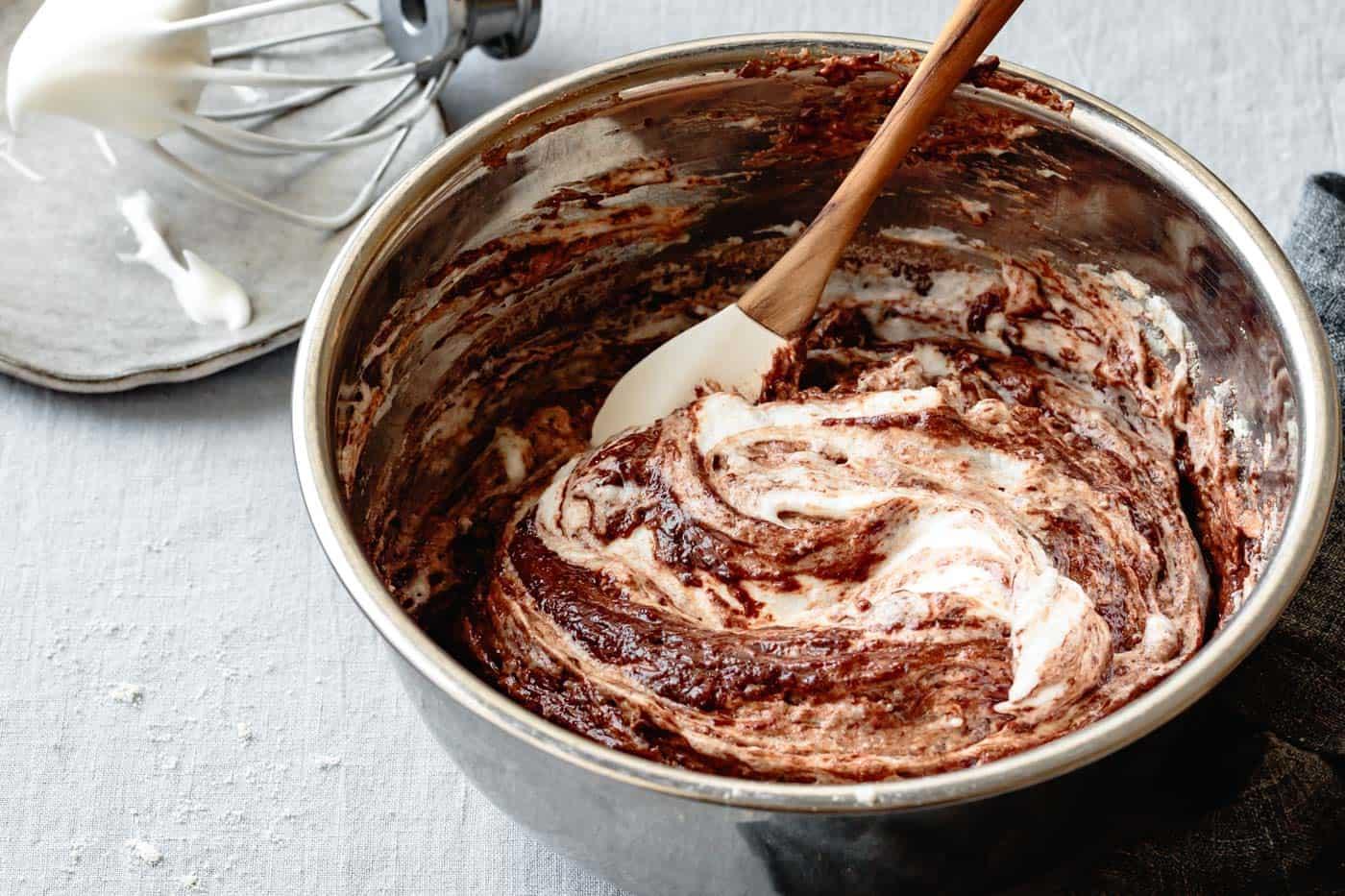 folding egg whites into chocolate olive oil cake batter