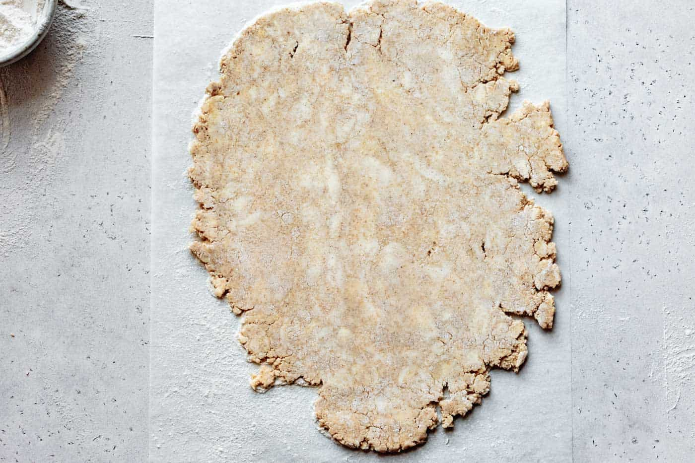 rolling out vegan almond flour pie crust