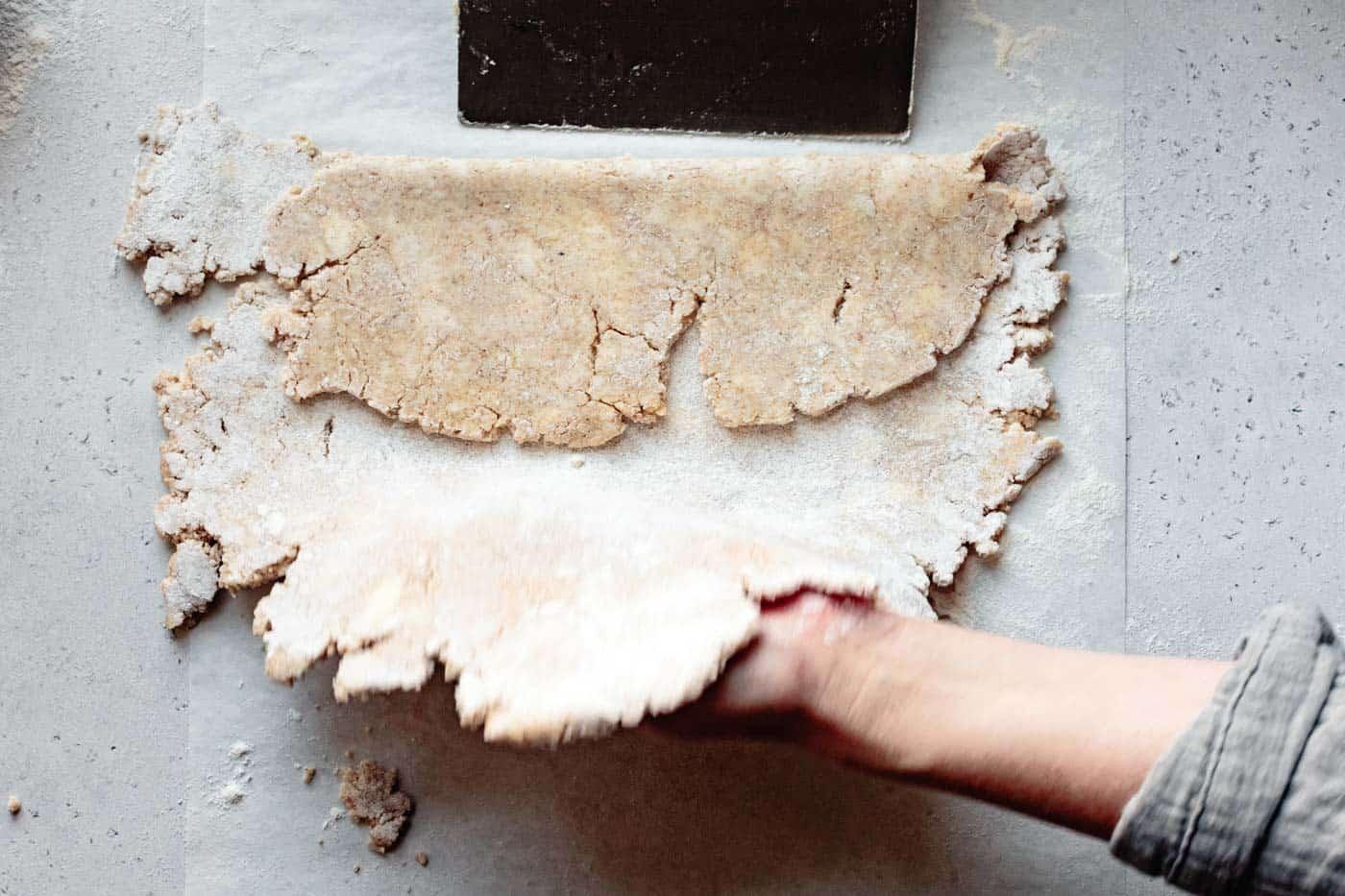 folding paleo pie dough in thirds