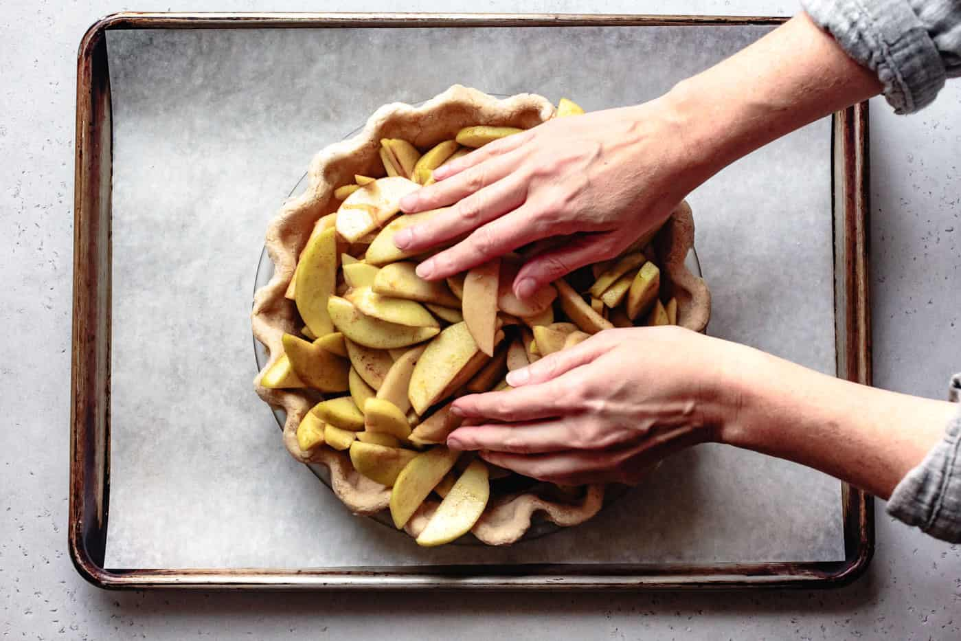 packing apples into crust for paleo apple pie recipe