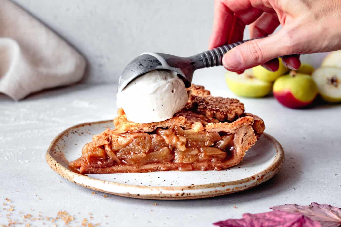 putting ice cream atop a slice of gluten-free apple pie