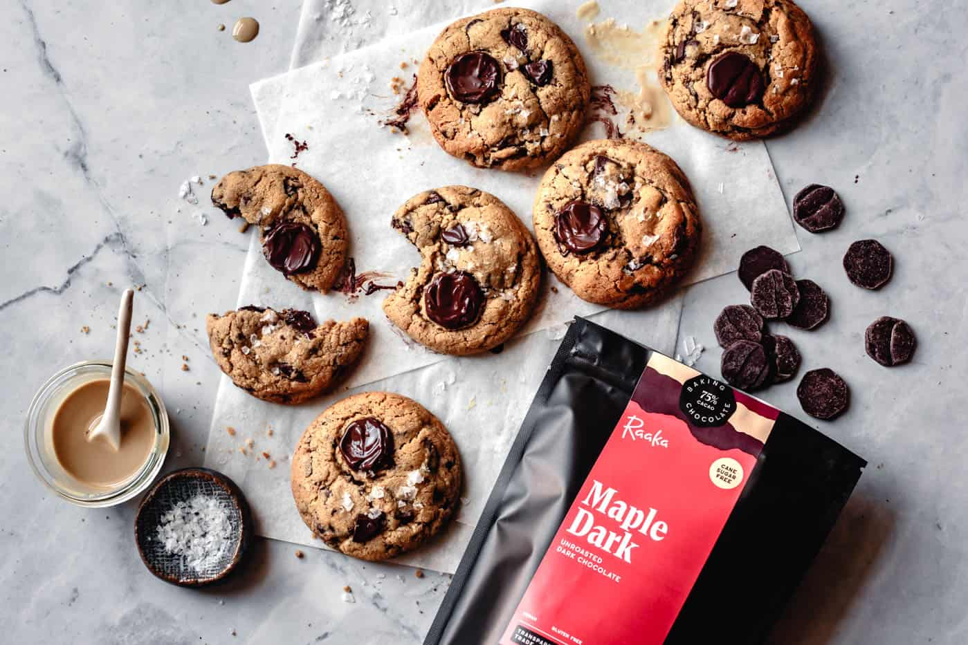 tahini cookies with a bag of maple dark chocolate, tahini, and flaky salt