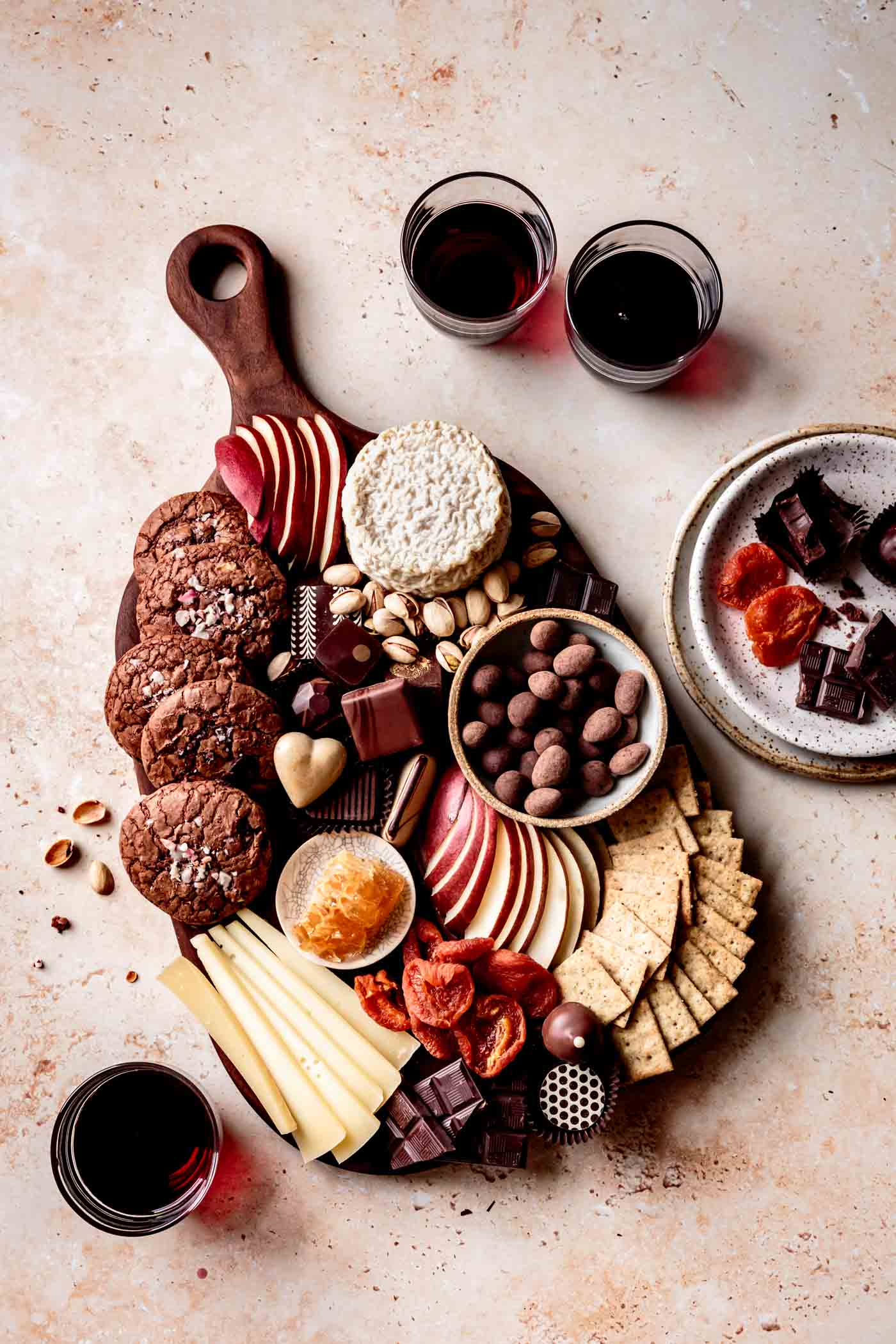 chocolate board overhead with glasses of red wine