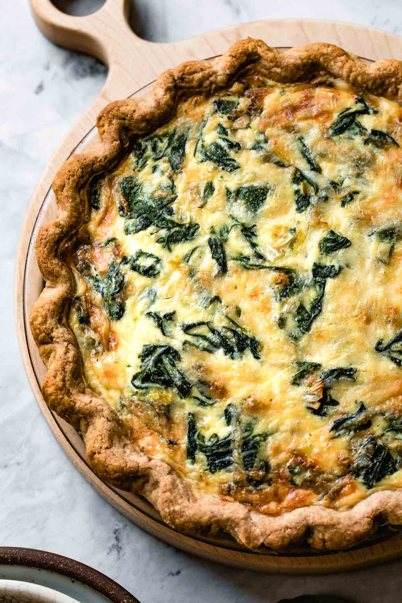 close-up of baked spinach and cheese quiche recipe