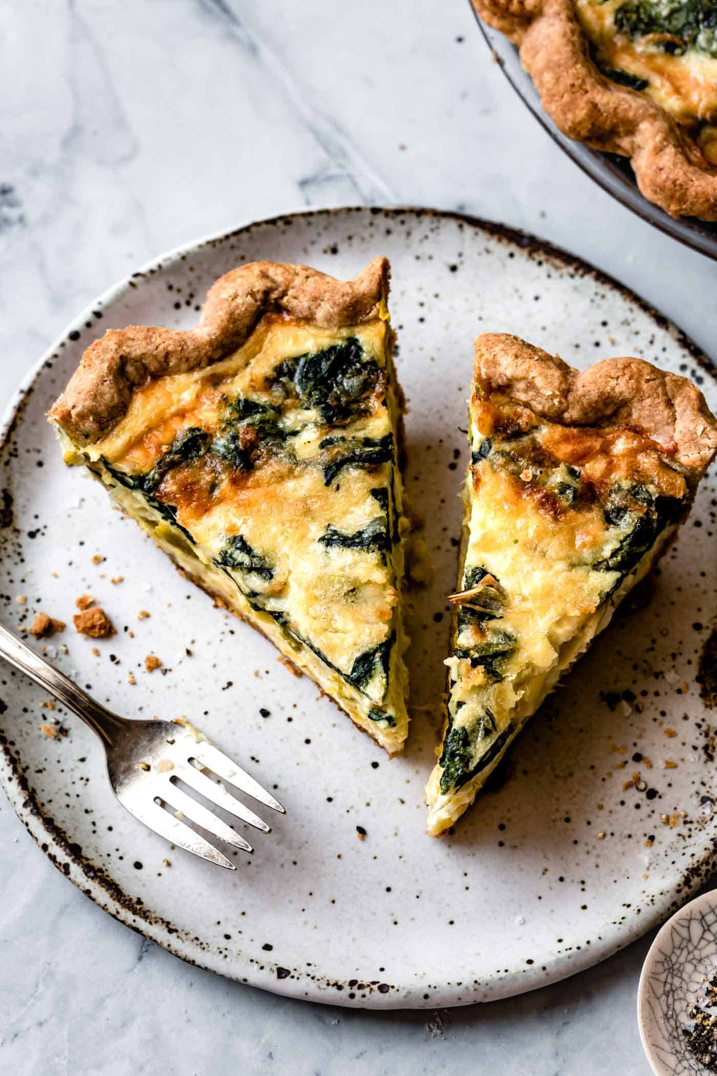 slices of gluten-free dairy-free quiche on a speckled plate