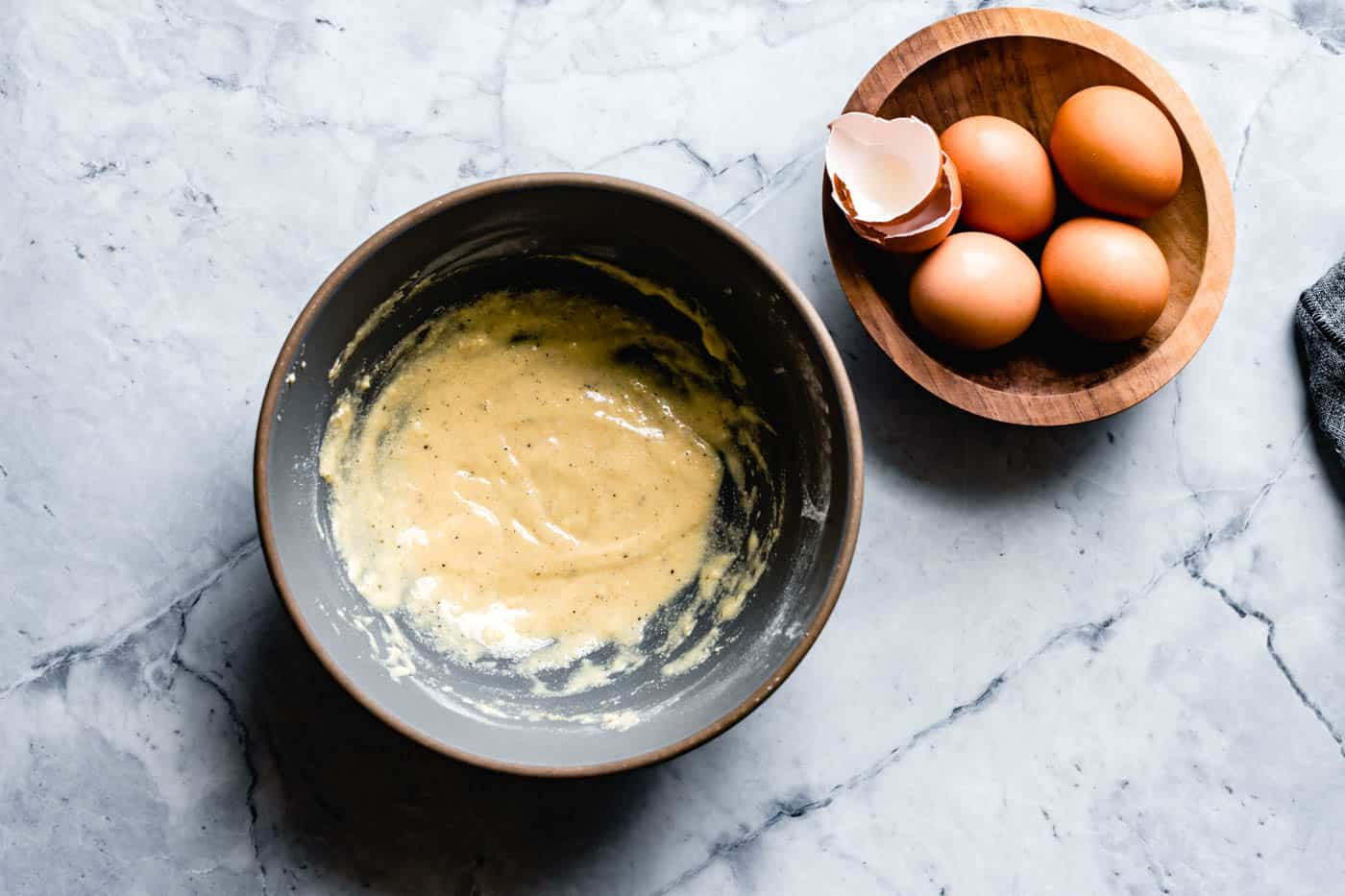 whisking eggs with flour for gluten-free quiche filling