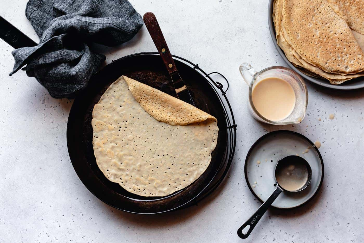 almond flour crepe cooking in a crepe pan