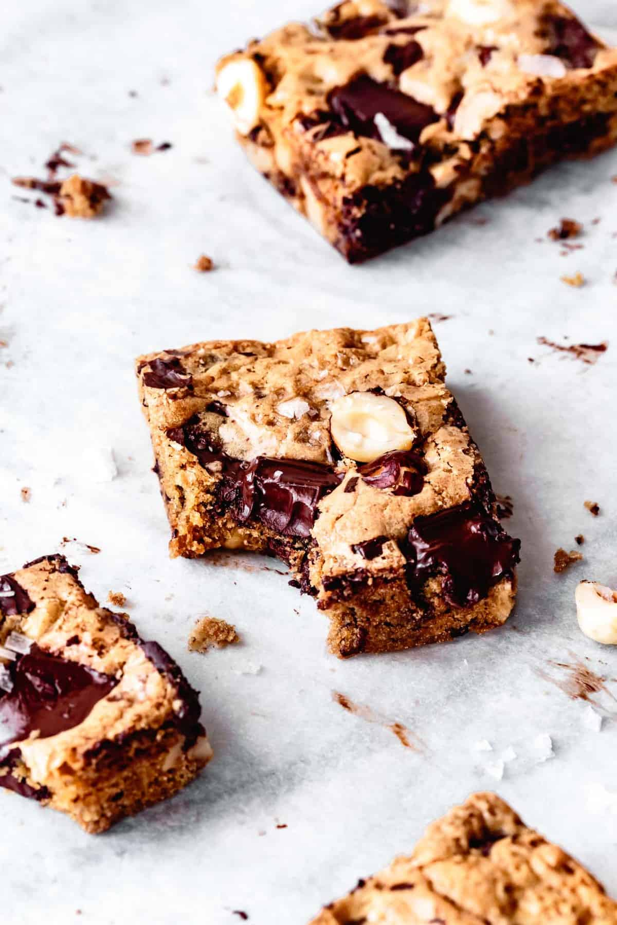 gluten-free blondies with a bite taken out on parchment paper
