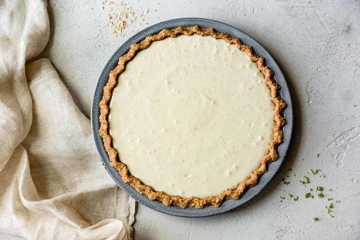 healthy key lime pie filling poured into crust