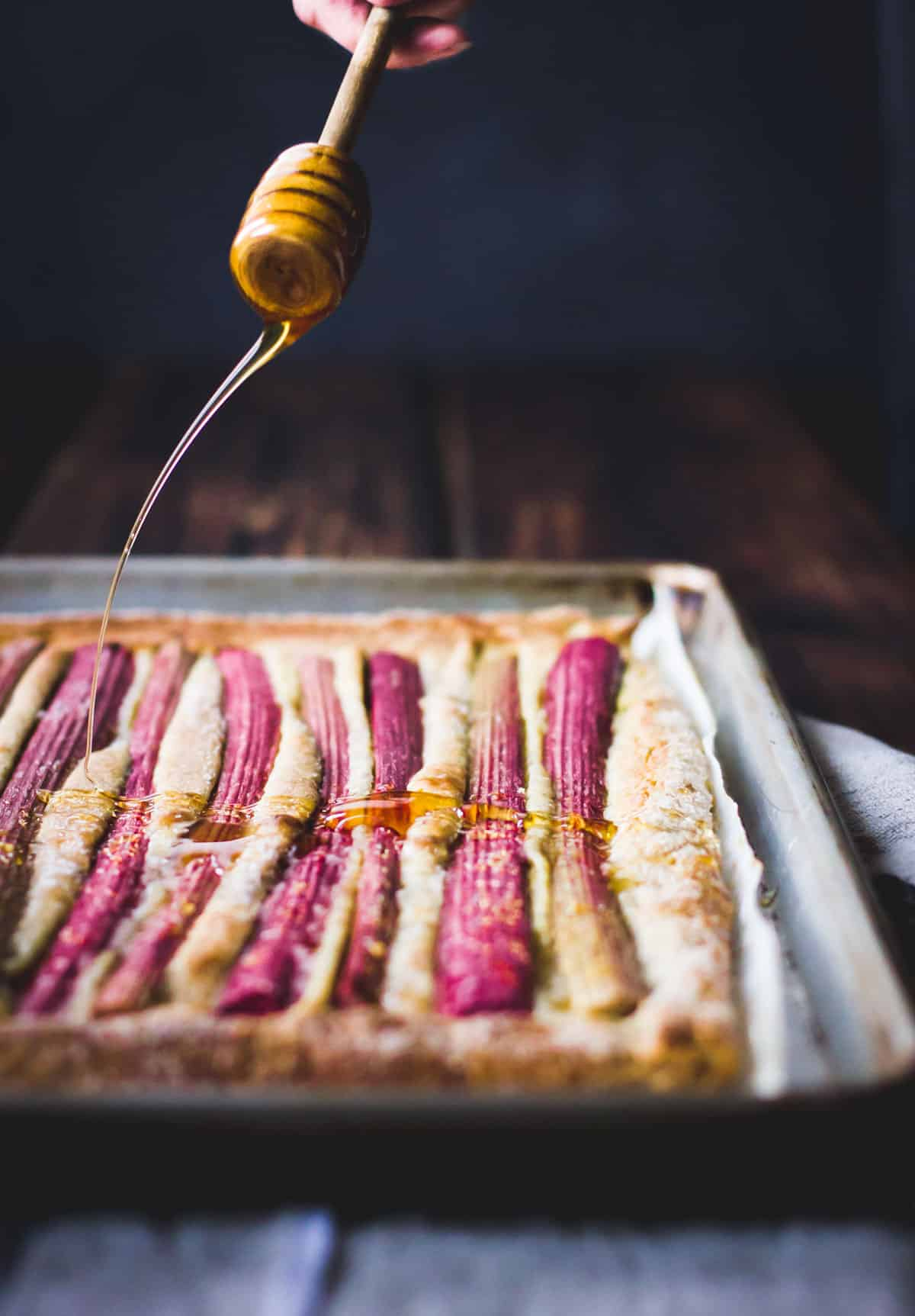 drizzling honey over a rhubarb tart