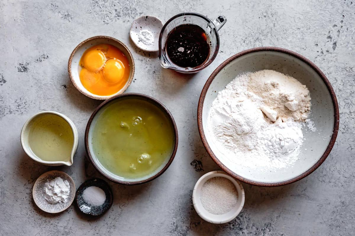 ingredients for gluten-free cake recipe on a stone surface