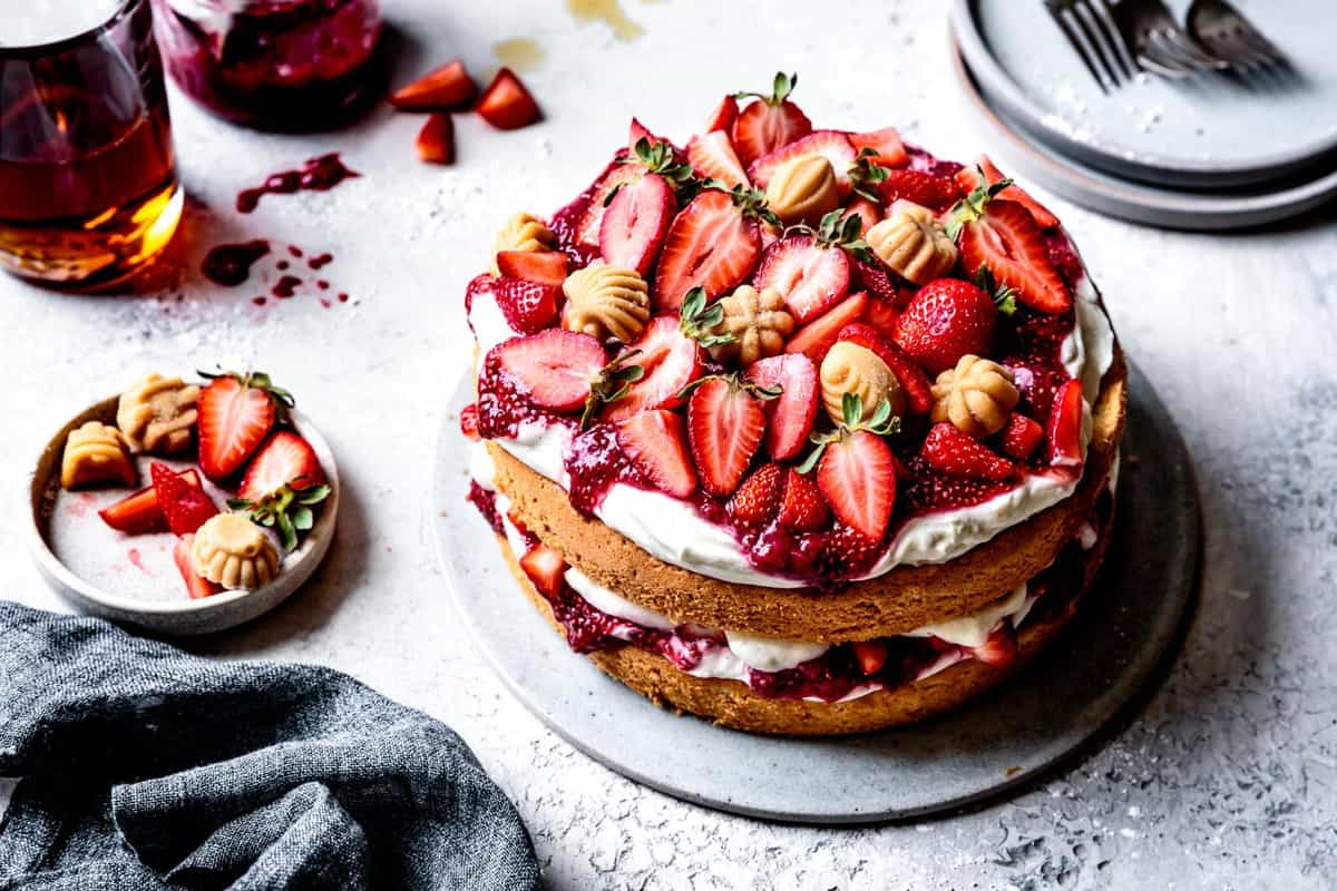 gluten-free layer cake with berries and cream