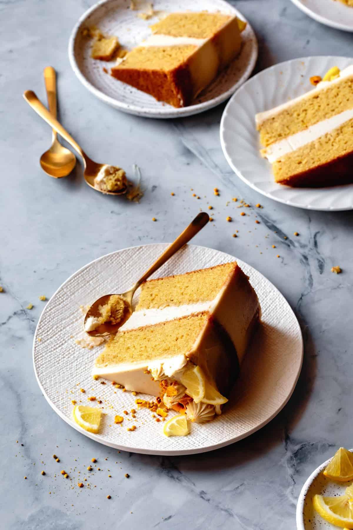 slices of paleo lemon cake on white ceramic plates