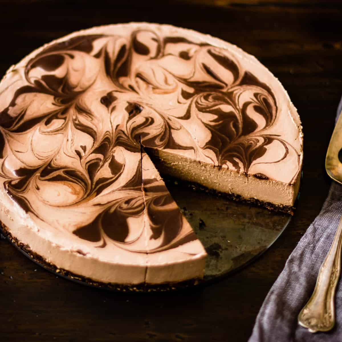 marbled raw vegan chocolate cheesecake with a slice taken out