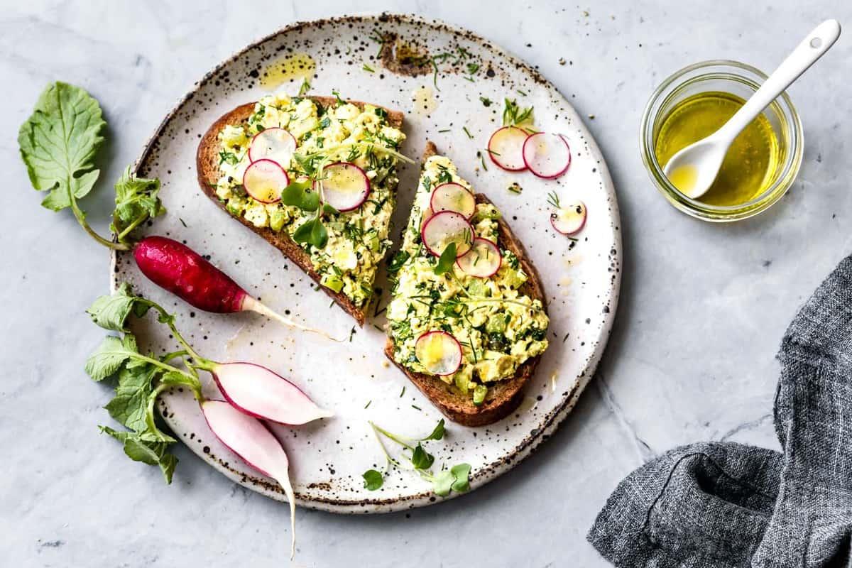 egg salad tartine on a fabulous speckled ceramic plate