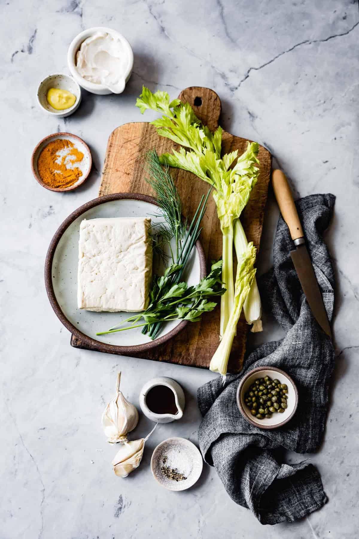 curried tofu salad ingredients on blue marble surface