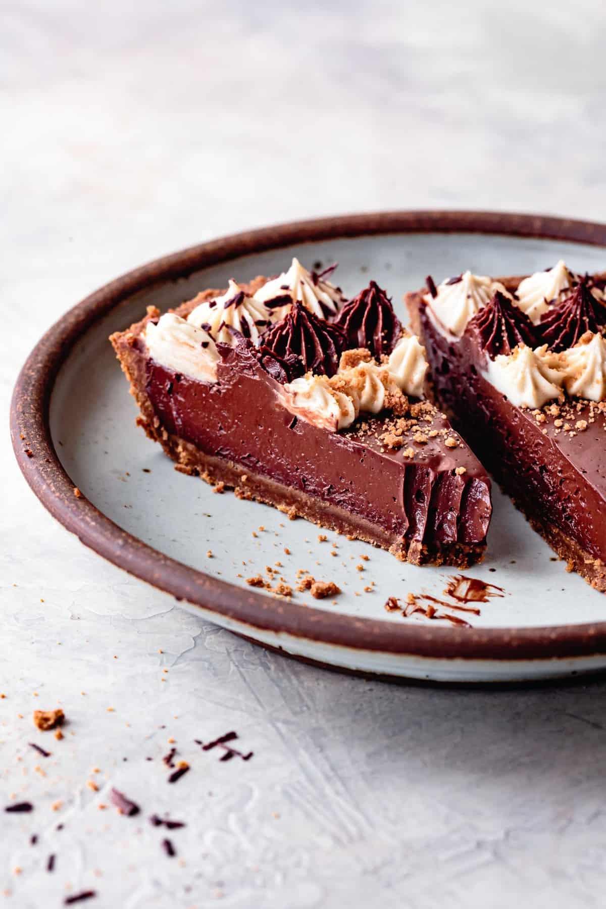 gluten free vegan chocolate pie slices on a blue plate