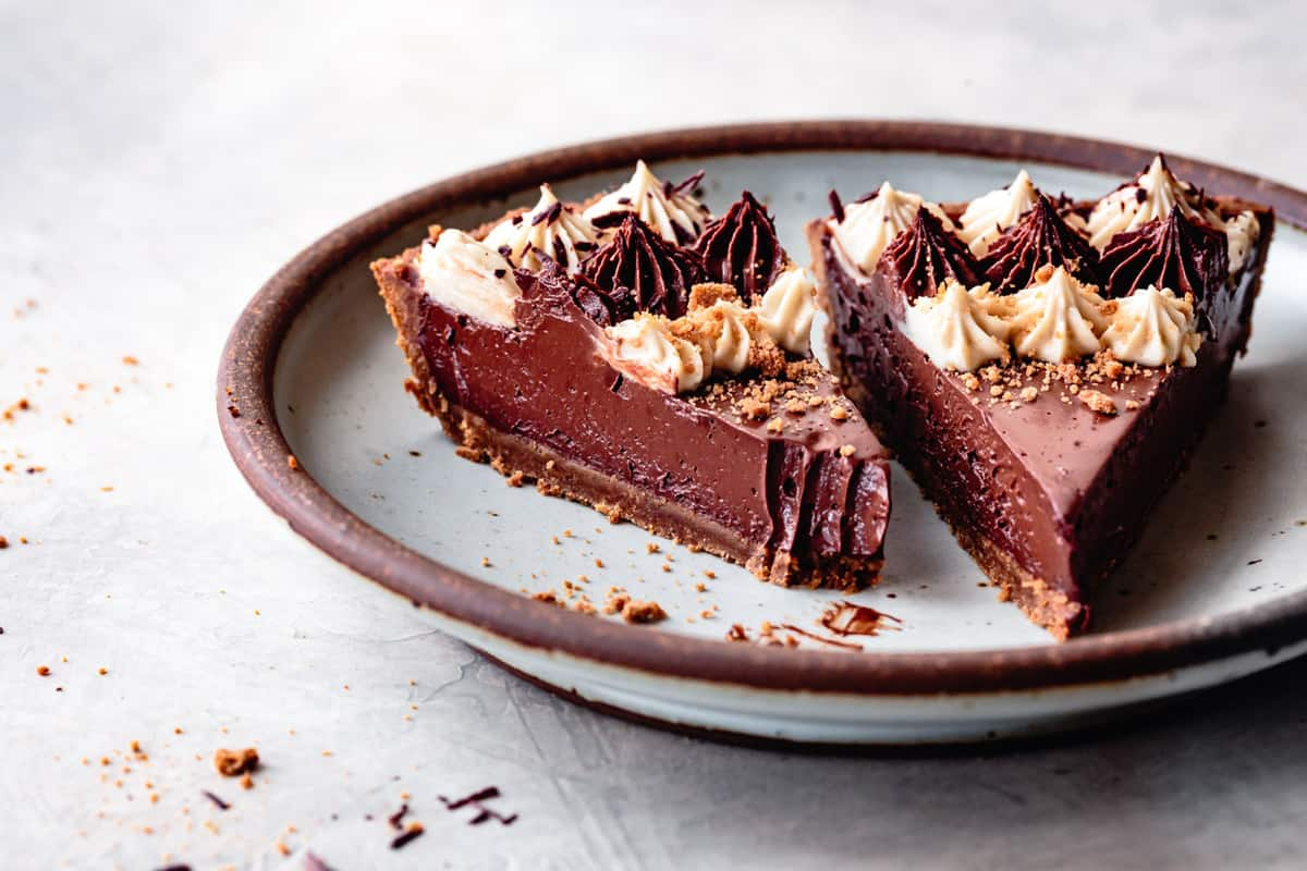 two slices of gluten-free chocolate pie on a blue plate, low angle