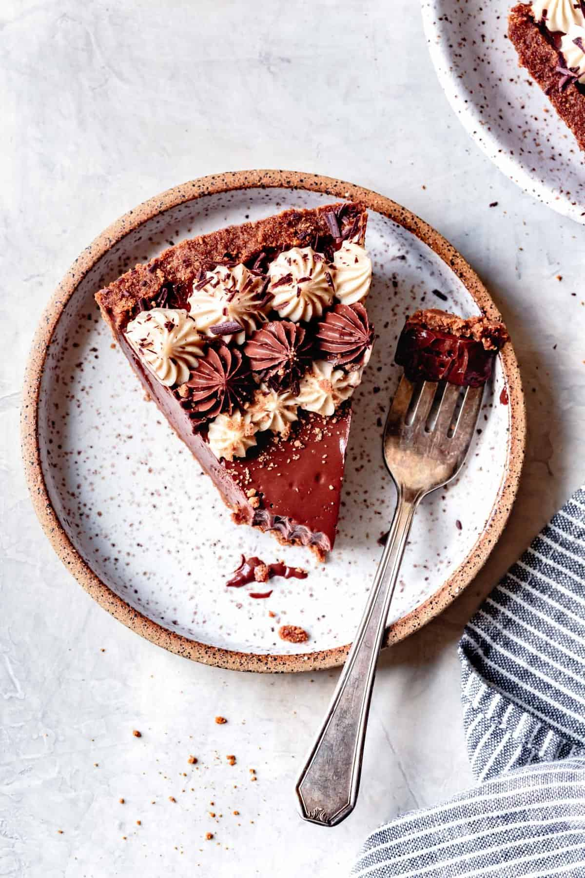 slice of chocolate pie with gf graham cracker crust on a plate